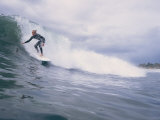 A Surfer Rides a Wave at Hammonds Beach Photographic Print by Rich Reid