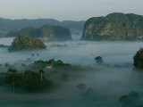 Fog Surrounds Mogotes in the Valle De Vinales at Sunrise Photographic Print by Steve Winter