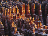 Rock Formations at Bryce Canyon with a Light Dusting of Snow Photographic Print by Norbert Rosing