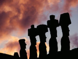 Silhouetted Moai Seen at Dusk Photographic Print by Gordon Gahan
