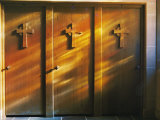 Confessional Doors are Bathed in Soft Sunlight Shining Through Stained Glass Windows Photographic Print by Brian Gordon Green