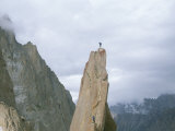 A Climber Stands Atop Tahir Tower, Karakoram Mountains, Pakistan Photographic Print by Jimmy Chin