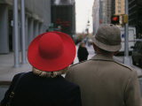 Rear View of Two People Wearing Hats Stopped at a Crosswalk Photographie par Raul Touzon