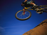 Cyclist Jumping, Arizona Photographic Print by David Edwards