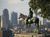 The Scout, a Statue of a Native American and a Horse, Overlooks a City Photographic Print by Michael S. Lewis