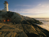 A Twilight View of the Peggys Cove Lighthouse Atop Smooth Rock Photographic Print by Michael S. Lewis
