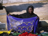 A Nubian Woman Sells Colorful Scarves on the Street Photographic Print by Stephen St. John