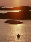 Rowboat Heads Toward a Series of Low-Lying Islands at Twilight Photographic Print by Thomas J. Abercrombie