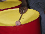 An Island Musician Plays a Brightly Colored Set of Steel Drums Photographie par Todd Gipstein