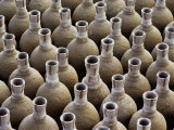 Newly-Made Clay Vases are Lined Up, Waiting to Be Baked in a Kiln Photographic Print by George F. Mobley