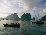 Sampans Ply the Placid Waters of Halong Bay Photographic Print by Steve Raymer