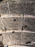 People Enjoy the View from the Ancient Stone Seats of a Roman Amphitheater Photographic Print by Richard Nowitz