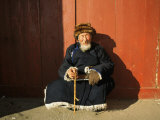 A Man Sits in the Sun in Ulaanbaatar, Mongolia Photographic Print by Ed George