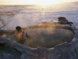 A Hiker Enjoys a Dip in a Hot Springs in Long Valley Photographic Print by Phil Schermeister