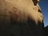 Indian Pictographs Cover a Sandstone Wall Photographic Print by Stephen Alvarez