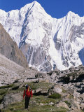 A Man Hikes Through the Karakoram Range, Pakistan Photographic Print by Jimmy Chin