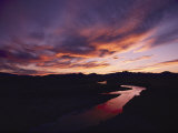 A Gorgeous Purple and Gold Sunset Tints Windswept Clouds and the Sweetwater River Photographic Print by Lowell Georgia