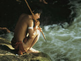 A Pinare Indian Sits by a Stream Fishing Photographic Print by Ed George