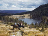 Two Horsemen Ride Above Pecos Baldy Lake Photographic Print by Justin Locke
