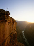 A Hiker Surveys the Grand Canyon from Atop Toroweap Overlook Photographic Print by John Burcham
