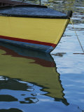 The Bow of an Anchored, Striped Boat is Reflected on the Water Photographic Print by Michael Melford