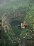 A Biologist Ascends Tawi Attair, a 200-Meter Deep Sinkhole Photographic Print by Stephen Alvarez
