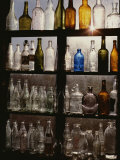 Rows of Old Bottles in a Flea Market Window Highlighted by the Sun Photographic Print by Stephen St. John