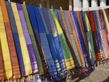 Colored Scarves Await Buyers at the Kom Ombo Marketplace Photographic Print by Stephen St. John