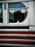 A Sign is Reflected in the Window of Local Diner Photographic Print by Stephen St. John