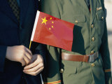 A Pair of Hands Holds the National Flag of China Photographic Print by Paul Chesley