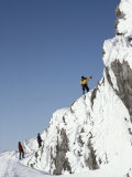 Mountain Climbers Descend a Rime-Plastered Peak Photographic Print by Gordon Wiltsie