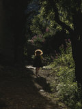 A Child Plays in a Garden in Provence Photographic Print by Nicole Duplaix