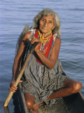 A Warao Indian in a Canoe Photographic Print by Ed George