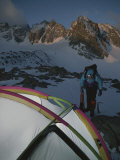 A Mountain Climber Prepares for a Dawn Start for His Ascent Photographic Print by Gordon Wiltsie