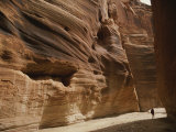 A Hiker is Dwarfed by the Sandstone Walls of a Utah Canyon Photographic Print by Dugald Bremner