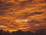 A Radiant Orange Sunset in the Clouds over Costa Rica Photographic Print by Tim Laman