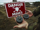 Deactivated Mines Held by a British Explosives Expert Photographic Print by Steve Raymer
