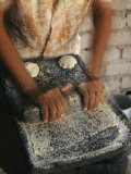 A Cora Woman Grinds Corn for Tortillas Lámina fotográfica por Stenzel, Maria