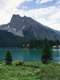 Horseback Riding Around Emerald Lake in Yoho National Park Photographic Print by Michael Melford
