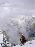 A Mountaineer Descends Near the Summit of Grand Teton in Wyoming Photographic Print by Gordon Wiltsie