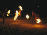 Polynesian Dancers Put on a Traditional Fire Dance Performance Photographic Print by Tim Laman