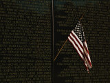 American Flag Left at the Vietnam Veterans Memorial Photographic Print by Medford Taylor