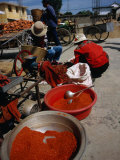 Women from Small Patou Island Grind Chilies to Powder, Dali, Yunnan, China Photographic Print by Diana Mayfield