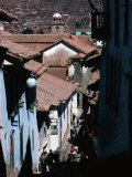 Steep and Narrow Hatunrumiyoc Street, with La Merced Tower in Distance, Cuzco, Peru Photographic Print by Richard I'Anson