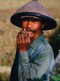 Portrait of a Farm Worker Smoking a Cigarette, Looking at Camera, Ubud, Indonesia Photographic Print by Kraig Lieb