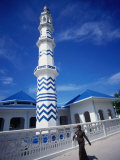 Woman Walking Past Minaret Eydhafushi, South Maalhosmadulu Atoll, Baa, Maldives Photographic Print by John Borthwick