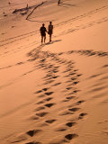 Couple Walking on Dunes, Great Sandy National Park, Australia Photographic Print by Wayne Walton