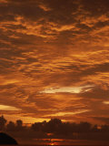 Sunset in a Cloudy Sky over the Pacific Ocean off of Costa Rica Photographic Print by Tim Laman