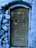 Wooden Door in Rubblestone Wall, Kalymnos, Greece Photographic Print by Jeffrey Becom