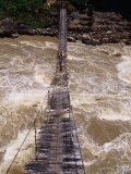 People Crossing Suspension Bridge Over Rapids of Ballem River, Bailum Gorge, Irian Jaya, Indonesia Photographic Print by Karl Lehmann